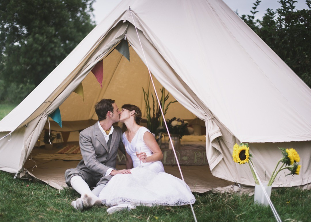 Bell Tent -  Their guests had secretly hirer them a bell-tent and pitched it behind the barn. It was fitted it out beautiful with fairly lights, champagne and a damn comfy looking bed. Now that's how to get married in a field!!